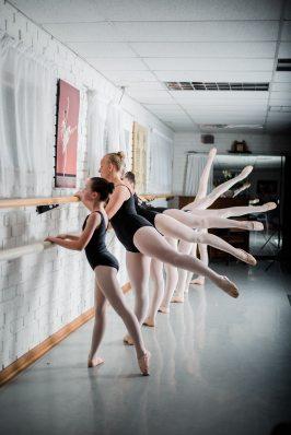group-of-girls-doing-ballet-exercise-1638734