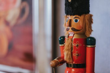 shallow-focus-photography-of-wooden-nutcracker-1697234