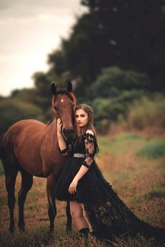 photo-of-woman-wearing-black-dress-beside-horse-2090704