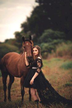 photo-of-woman-wearing-black-dress-beside-horse-2090704